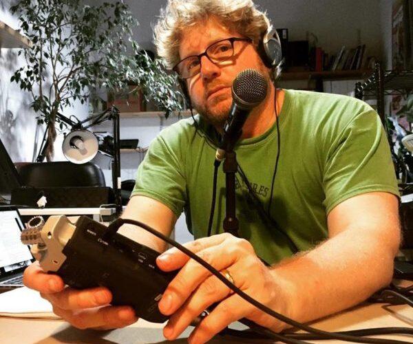 Josh Neufeld at the mic